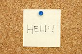 Note On Corkboard Asking For Help