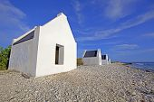 stock photo of slave-house  - Historical white slave huts on Bonaire Caribbean - JPG