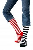 foto of knee-high socks  - feet with mismatched striped socks isolated on a white background - JPG