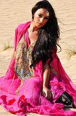 Beautiful Sexy Lady In Pink Oriental Dress In Arabic Desert