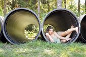 Beautiful Teen Girl in a Large Pipe