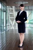 business woman smiling and stand in morden office