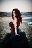 Beautiful Sad Goth Girl Standing On Sea Shore. Rear View poster