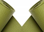 image of yoga mat  - Green Yoga Exercise Mats Partially Rolled Border Image - JPG