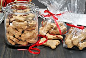 picture of bag-of-dog-food  - Homemade dog bones being packaged into cellophane bags as healthy gifts for dogs - JPG
