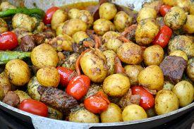 pic of cauldron  - Big cauldron with roasted potato - JPG