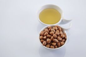 image of ground nut  - bowl of oil and ground nut - JPG