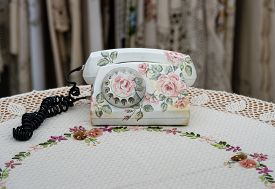 stock photo of decoupage  - Old phone set made  in decoupage technique - JPG