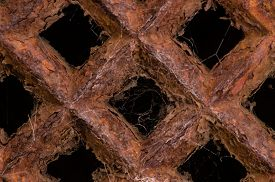 image of grating  - Close up of a rusty grate cover - JPG