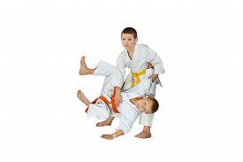 foto of judo  - Throw Judo performs athlete with yellow belt - JPG