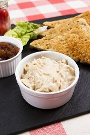 pic of canard  - a pot of creamy salmon pate on a slate plate with pickle and triangles of toast - JPG