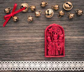 stock photo of magi  - Christmas decoration of wax the three Magi bells lace on wood - JPG
