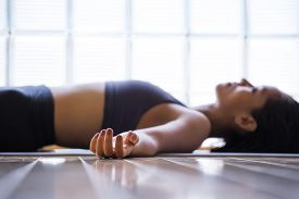 picture of corps  - Young woman practicing in a yoga studio - JPG