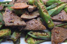 stock photo of okras  - Stir fried pork liver with okra - JPG