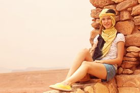 stock photo of yashmak  - Capture of Beautiful women wearing turban in desert - JPG