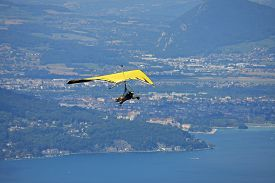 picture of glider  - hang glider flying above Lake Annecy in France