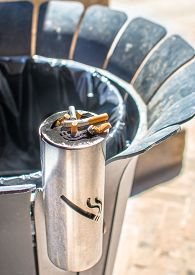 foto of stelles  - stell metal public ashtray cigarettes bin  - JPG