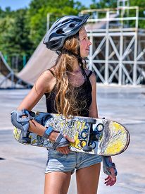 pic of skateboard  - Teen in  shorts skateboarding  his skateboard outdoor - JPG
