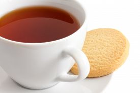 picture of shortbread  - Detail of a white ceramic cup of rooibos tea with shortbread biscuits.