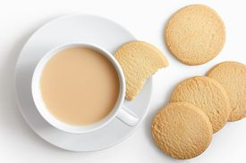 foto of shortbread  - White cup of tea and saucer with shortbread biscuits from above - JPG