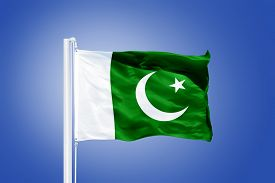image of pakistani flag  - Flag of Pakistan flying against a blue sky - JPG