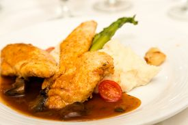 picture of marsala  - A dinner of chicken marsala with mashed potatoes and asparagus - JPG