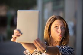 foto of snob  - Woman posing for picture for tablet computer self - JPG
