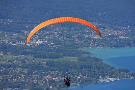 stock photo of annecy  - paraglider flying above Lake Annecy in France - JPG