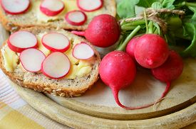 stock photo of radish  - Slices of radish on cereal bread and bunch of radishes - JPG