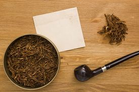 stock photo of tobacco-pipe  - Women tobacco pipe with a long shank and tobacco - JPG