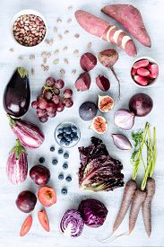 stock photo of radish  - Collection of fresh purple toned vegetables and fruits on white rustic background - JPG