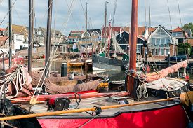 image of historical ship  - Historic wooden ships in harbor of Urk an old Dutch fishing village - JPG