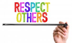 stock photo of respect  - Hand with marker writing the word Respect Others - JPG