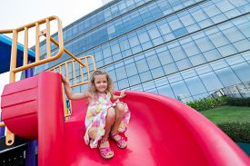 picture of chute  - Happy pretty girl sliding on chute outdoors - JPG