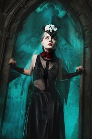stock photo of wraith  - Scary girl standing in the doorway of an old castle - JPG