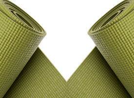 foto of yoga mat  - Green Yoga Exercise Mats Partially Rolled Border Image - JPG