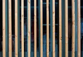 image of fin  - Vertical wooden fin facade of modern building - JPG