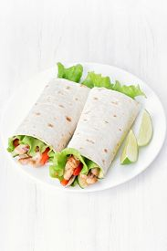 foto of sandwich wrap  - Wrap sandwiches with chicken and vegetables on white table top view - JPG