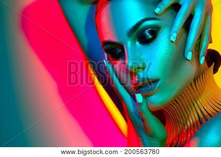 poster of High Fashion model woman in colorful bright lights posing in studio, portrait of beautiful sexy girl