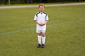 proud player for a young youth soccer team looks proud in his tricot