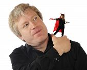 pic of she devil  - An annoyed mature man removing a devil from his shoulder - JPG