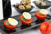 Quail Eggs And Tomatoes