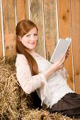 Young Romantic Woman In Barn Hold Book