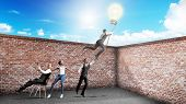 Concept Of A Successful Team Idea A Light Bulb That Pulls People Up 3D Render poster