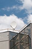 Satellite dish on the modern building roof