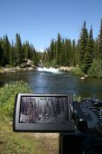 foto of beartooth  - A camera upclose filming a waterfall in Beartooth mountains - JPG