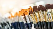 Group Of Artistic Paintbrushes For Artist. New Paint Brushes On Shelf Display In Stationery Shop. Ar poster