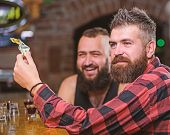 Hipster Brutal Bearded Man Spend Leisure With Friend At Bar Counter. Men Relaxing At Bar. Friendship poster