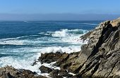 Cliff With Waves Breaking, Mist And Blue Sky. Galicia, Spain. poster