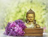 Buddha Statue And Blooming Lilac Buddha Head. Buddha Background poster